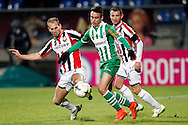 Onderwerp/Subject: Willem II - PEC Zwolle - Eredivisie<br /> Reklame:  <br /> Club/Team/Country: <br /> Seizoen/Season: 2014/2015<br /> FOTO/PHOTO: Max de BOOM (C) of PEC Zwolle in duel with Frank VAN DER STRUIJK (L) of Willem II and Robbie HAEMHOUTS (R) of Willem II. (Photo by PICS UNITED)<br /> <br /> Trefwoorden/Keywords: <br /> #04 #22 $64 ±1401974349562<br /> Photo- & Copyrights © PICS UNITED <br /> P.O. Box 7164 - 5605 BE  EINDHOVEN (THE NETHERLANDS) <br /> Phone +31 (0)40 296 28 00 <br /> Fax +31 (0) 40 248 47 43 <br /> http://www.pics-united.com <br /> e-mail : sales@pics-united.com (If you would like to raise any issues regarding any aspects of products / service of PICS UNITED) or <br /> e-mail : sales@pics-united.com   <br /> <br /> ATTENTIE: <br /> Publicatie ook bij aanbieding door derden is slechts toegestaan na verkregen toestemming van Pics United. <br /> VOLLEDIGE NAAMSVERMELDING IS VERPLICHT! (© PICS UNITED/Naam Fotograaf, zie veld 4 van de bestandsinfo 'credits') <br /> ATTENTION:  <br /> © Pics United. Reproduction/publication of this photo by any parties is only permitted after authorisation is sought and obtained from  PICS UNITED- THE NETHERLANDS