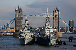 © Licensed to London News Pictures. 13/03/2013, London, UK. A Royal Navy type 23 frigate, HMS Westminster, left, moors alongside HMS Belfast on the River Thames in London, Wednesday, March 13, 2013. HMS Westminster is on a six-day visit to London. Photo credit : Sang Tan/LNP