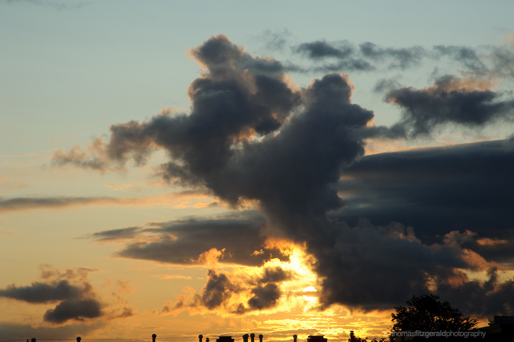 Dramatic CLoud Formations over rooftops in the Evening Sky