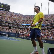 Fabio Fognini, Italy, reacts after throwing his racquet after the ball after playing a shot through his legs during his match with Andy Roddick, USA,  during the US Open Tennis Tournament, Flushing, New York. USA. 2nd September 2012. Photo Tim Clayton
