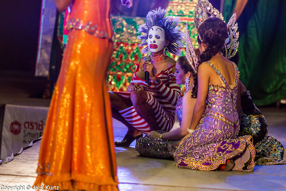22 NOVEMBER 2013 - BANGKOK, THAILAND: The Prathom Bunteung Silp mor lam troupe performs in Bangkok. Mor Lam is a traditional Lao form of song in Laos and Isan (northeast Thailand). It is sometimes compared to American country music, song usually revolve around unrequited love, mor lam and the complexities of rural life. Mor Lam shows are an important part of festivals and fairs in rural Thailand. Mor lam has become very popular in Isan migrant communities in Bangkok. Once performed by bands and singers, live performances are now spectacles, involving several singers, a dance troupe and comedians. The dancers (or hang khreuang) in particular often wear fancy costumes, and singers go through several costume changes in the course of a performance. Prathom Bunteung Silp is one of the best known Mor Lam troupes in Thailand with more than 250 performers and a total crew of almost 300 people. The troupe has been performing for more 55 years. It forms every August and performs through June then breaks for the rainy season.     PHOTO BY JACK KURTZ