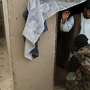 A soldier from the Afghan National Army (ANA) searches a civilian in a compound also searched by Canadian soldiers which is suspected of harboring insurgents during Operation Matawarkawel Sheppa in the Pashmul area in Zhari District located west of Kandahar City, Afghanistan. The operation was a Canadian lead effort in coordination with the Afghan National Army (ANA) and Royal Gurkha Rifles from the British Army. The Pashmul area has become well known for frequent insurgent activity and attacks on coalition forces.