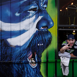 A Seattle Seahawks fan watches Super Bowl XLVIII at the Hawk's Nest bar in Seattle, Washington February 2, 2014. The Seahawks meet the Denver Broncos for the big game Sunday in  East Rutherford, New Jersey.  REUTERS/Jason Redmond  (UNITED STATES)