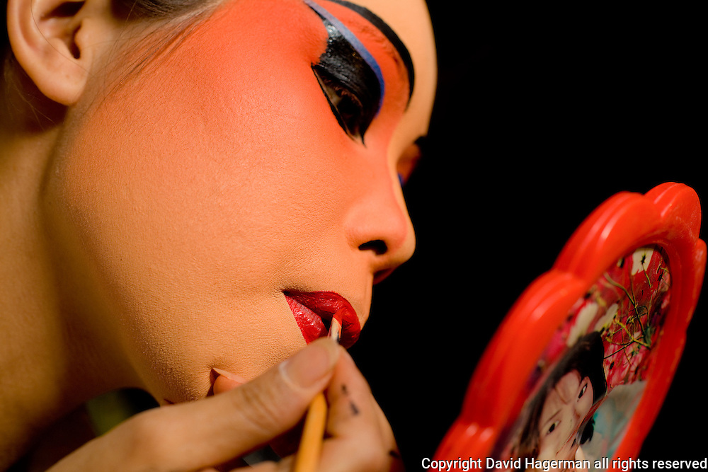 a chinese opera performer prepares for an evening performance, Chiang Mai, Thailand