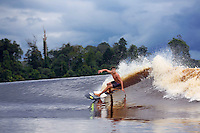 Mikey Barber surfing on the Kampar River on the wave known as Bono (7 Ghosts). Sumatra, Indonesia.