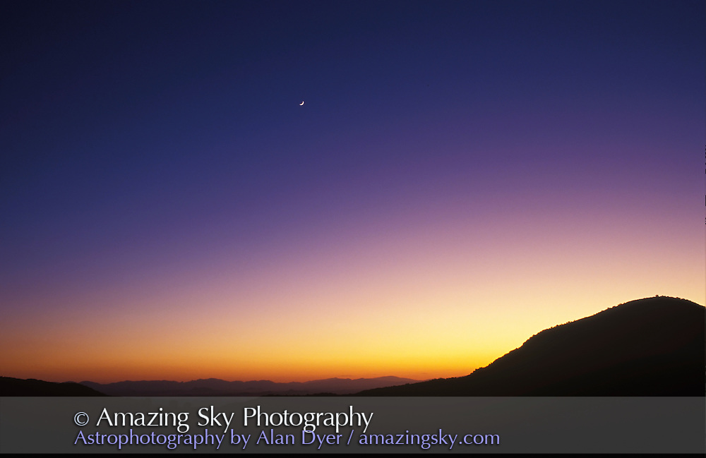 Arizona evening twilight (normal spectrum of colours), with waxing crescent Moon in sky.<br /> <br /> May 1995, Chiracahua National Monument, Massai Point<br /> <br /> 28mm lens, Fuji Velvia 50 slide film