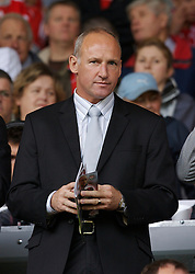 Liverpool, England - Saturday, September 1, 2007: Former Everton defender Dave Watson watches Liverpool take on Derby County during the Premiership match at Anfield. (Photo by David Rawcliffe/Propaganda)