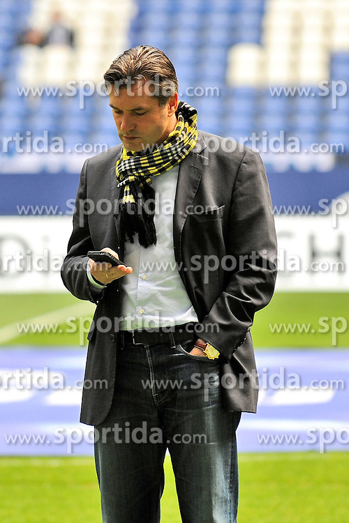 14.04.2012, Veltins Arena, Gelsenkirchen, GER, Schalke 04 vs Borussia Dortmund, 31. Spieltag, im Bild Manager Michael Zorc ( Borussia Dortmund/ Portrait ) ist mit seinem Handy beschaeftigt // during the German Bundesliga Match, 31th Round between Schalke 04 and Borussia Dortmund at the Veltins Arena, Gelsenkirchen, Germany on 2012/04/14. EXPA Pictures © 2012, PhotoCredit: EXPA/ Eibner/ Alexander Neis..***** ATTENTION - OUT OF GER *****