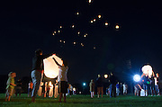 Families and students of the Trinity Lutheran Church and School in Marysville, Ohio send lanterns into the night sky during the community's Sky Lanterns of Love 911 memorial on Sunday, September 11, 2011. Each lantern carried hand written prayers into the night in remembrance of those who lost their lives on 911. (ViCo581, fall 2011 photo by Kate Munsch)