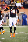 Cincinnati Bengals defensive end Carlos Dunlap (96) jumps up and down between plays during the NFL AFC Wild Card playoff football game against the Pittsburgh Steelers on Saturday, Jan. 9, 2016 in Cincinnati. The Steelers won the game 18-16. (©Paul Anthony Spinelli)