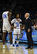 Nov 15, 2019; Los Angeles, CA, USA; UCLA Bruins head coach Mick Cronin talks with forward Jalen Hill (24) and guard Tyger Campbell (10)  in the second half against the UNLV Rebels at Pauley Pavilion. UCLA defeated UNLV 71-54.