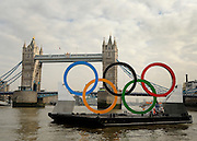 © Licensed to London News Pictures. 28/02/2012, London, UK. Tower Bridge.  Giant Olympic rings measuring 11 metres high by 25 metres wide are floated down the River Thames on a barge, marking 150 days to go to the start of the London 2012 Olympic and Paralympic Games. Photo credit : Stephen Simpson/LNP