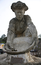 Scuplture of Gold Rush miner Claude Chana panning for gold, by Dr. Kenneth H. Fox, Auburn, California, United States of America