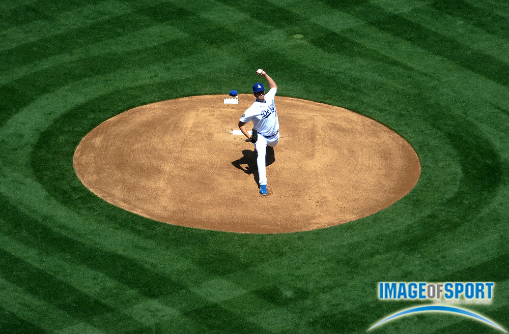Apr 10, 2012; Los Angeles, CA, USA; Los Angeles Dodger starter Clayton Kershaw (22) delivers a pitch against the Pittsburgh Pirates in the 2012 opening day game at Dodger Stadium.