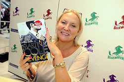 """© Licensed to London News Pictures. 26/10/2013<br /> Crime writer Martina Cole at W H Smiths in Bluewater Shopping Complex, Kent (today 26.10.2013) signing copies of her book """"Revenge""""<br /> Photo credit :Grant Falvey/LNP"""