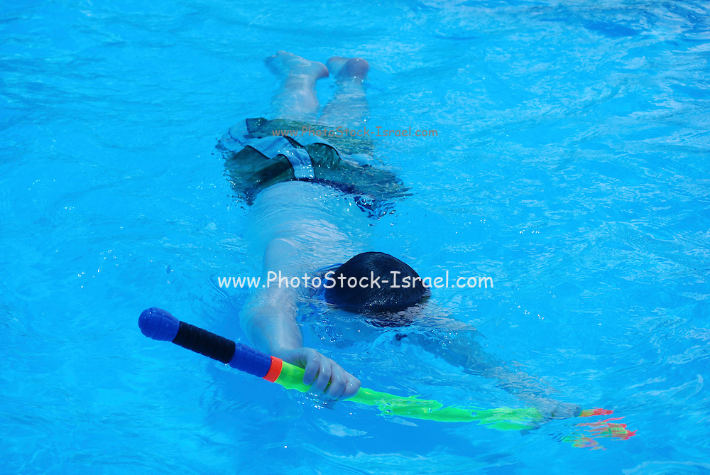 young boy of 7 swimming underwater Model Release available
