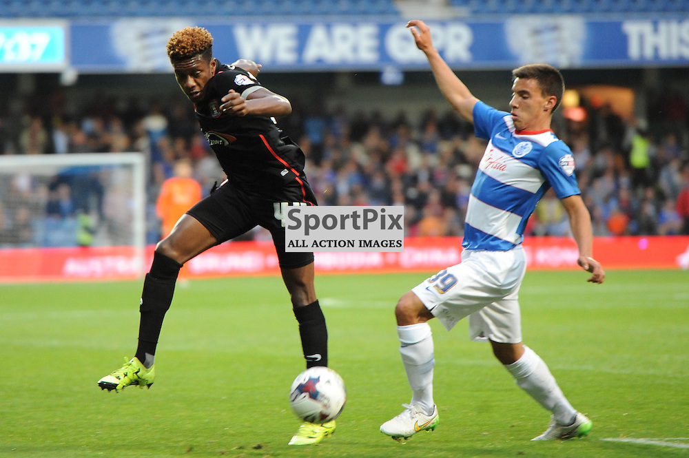 QPRs Reece Grego-Cox and Carlisles Alexander McQueen in action during Queens Park Rangers v Carlisle Captial One Cup 2nd round tie on Tuesday 25th August