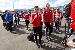 LILLE, FRANCE - Saturday, July 2, 2016: Wales' Neil Taylor boards their team plane as they head back to the team base in Dinard after reaching the Semi-Final with a 3-1 victory over Belgium in the UEFA Euro 2016 Championship Quarter-Final match. (Pic by David Rawcliffe/Propaganda)