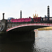Sister Not Cister UK protests demonstration Justice for #Stansted15! Stop the Jamaica Charter Flight! with heavy police present Stop the racist hostile environment drop a banner on Lambeth bridge and march to the Home Office demand to free the #Stansted15 will be Sentencing non-violent peaceful direct action, all of them charged with a terrrorism-related offence that carries a maximum life prison sentence at Chelmsford Crown Court of and Stop deportation, London, UK. 6 Feb 2019.
