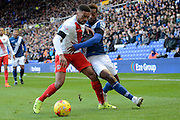 Birmingham City midfielder Jacques Maghoma and Charlton Athletic defender Tareiq Holmes-Dennis during the Sky Bet Championship match between Birmingham City and Charlton Athletic at St Andrews, Birmingham, England on 21 November 2015. Photo by Alan Franklin.