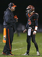 Springville head coach Joe Martin talks with quarterback Sam Scriver (3) during their game at Allison Field in Springville on Friday October 19, 2012. Midland defeated Springville 30-29.