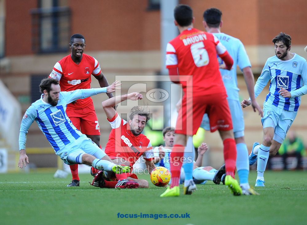 Jim O'Brien of Coventry City (left) slides in on Gianvito Plasmati of Leyton Orient  during the Sky Bet League 1 match at the Matchroom Stadium, London<br /> Picture by Alan Stanford/Focus Images Ltd +44 7915 056117<br /> 01/11/2014
