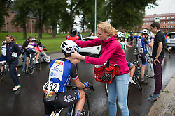Hitec Products Cycling Team soigneur Geerike Schreurs helps the helmet off the head of Cecilie Gotaas<br /> Johnsen after finishing the 97,1 km second stage of the 2016 Ladies' Tour of Norway women's road cycling race on August 13, 2016 between Mysen and Sarpsborg, Norway. (Photo by Balint Hamvas/Velofocus)