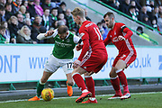 Martin Boyle (#17) of Hibernian attempts to defend the ball against Gary Mackay-Steven (#11) of Aberdeen and Niall McGinn (#17) of Aberdeen during the Ladbrokes Scottish Premiership match between Hibernian and Aberdeen at Easter Road, Edinburgh, Scotland on 17 February 2018. Picture by Craig Doyle.