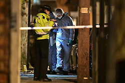 © Licensed to London News Pictures. 29/01/2020. London, UK. The scene in Queen's Park, west London after a man was shot earlier today. Police say they were called at 2. 44pm. Armed officers and London's air ambulance attended. Photo credit: Ben Cawthra/LNP