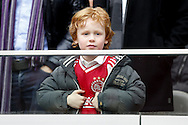 Onderwerp/Subject: Ajax - NEC - Eredivisie<br /> Reklame:  <br /> Club/Team/Country: <br /> Seizoen/Season: 2012/2013<br /> FOTO/PHOTO: Young supporter of Ajax. (Photo by PICS UNITED)<br /> <br /> Trefwoorden/Keywords: <br /> #11 $94 ±1355239233217<br /> Photo- & Copyrights © PICS UNITED <br /> P.O. Box 7164 - 5605 BE  EINDHOVEN (THE NETHERLANDS) <br /> Phone +31 (0)40 296 28 00 <br /> Fax +31 (0) 40 248 47 43 <br /> http://www.pics-united.com <br /> e-mail : sales@pics-united.com (If you would like to raise any issues regarding any aspects of products / service of PICS UNITED) or <br /> e-mail : sales@pics-united.com   <br /> <br /> ATTENTIE: <br /> Publicatie ook bij aanbieding door derden is slechts toegestaan na verkregen toestemming van Pics United. <br /> VOLLEDIGE NAAMSVERMELDING IS VERPLICHT! (© PICS UNITED/Naam Fotograaf, zie veld 4 van de bestandsinfo 'credits') <br /> ATTENTION:  <br /> © Pics United. Reproduction/publication of this photo by any parties is only permitted after authorisation is sought and obtained from  PICS UNITED- THE NETHERLANDS