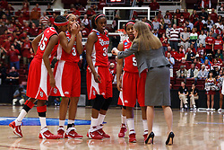 March 21, 2011; Stanford, CA, USA; St. John's Red Storm head coach Kim Barnes Arico (right) talks to her team during the first half of the second round of the 2011 NCAA women's basketball tournament against the Stanford Cardinal at Maples Pavilion.