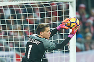 Wroclaw, Poland - 2016 November 14: Goalkeeper Wojciech Szczesny of Poland controls the ball during Poland v Slovenia - International Friendly Soccer Match at Municipal Stadium on November 14, 2016 in Wroclaw, Poland.<br /> <br /> Adam Nurkiewicz declares that he has no rights to the image of people at the photographs of his authorship.<br /> <br /> Picture also available in RAW (NEF) or TIFF format on special request.<br /> <br /> Any editorial, commercial or promotional use requires written permission from the author of image.<br /> <br /> Mandatory credit:<br /> Photo by © Adam Nurkiewicz / Mediasport