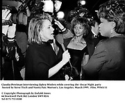 Claudia Perelman interviewing Ophra Winfrey while covering the  Oscar Night party hosted by Steve Tisch and Vanity Fair. Morton's. Los Angeles. March 1995. 95543/11<br />