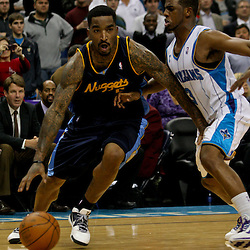 Dec 18, 2009; New Orleans, LA, USA; Denver Nuggets guard J.R. Smith (5) drives past New Orleans Hornets guard Chris Paul (3) during the second half at the New Orleans Arena. The Hornets defeated the Nuggets 98-92. Mandatory Credit: Derick E. Hingle-US PRESSWIRE