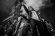 Protesters shout slogans against  Donald Trump in front of Trump Tower in New York, Wednesday, Nov. 9, 2016.