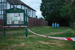 © Licensed to London News Pictures. 07/06/2020. London, UK. Three forensic investigators walk out of an entrance to Fryent Country Park cordoned off with police tape. The bodies of two women have been found in Fryent Country Park in Wembley. Metropolitan Police Service were called at 13:08 BST, Officers found two unresponsive woman, they were pronounced dead at the scene. Photo credit: Peter Manning/LNP