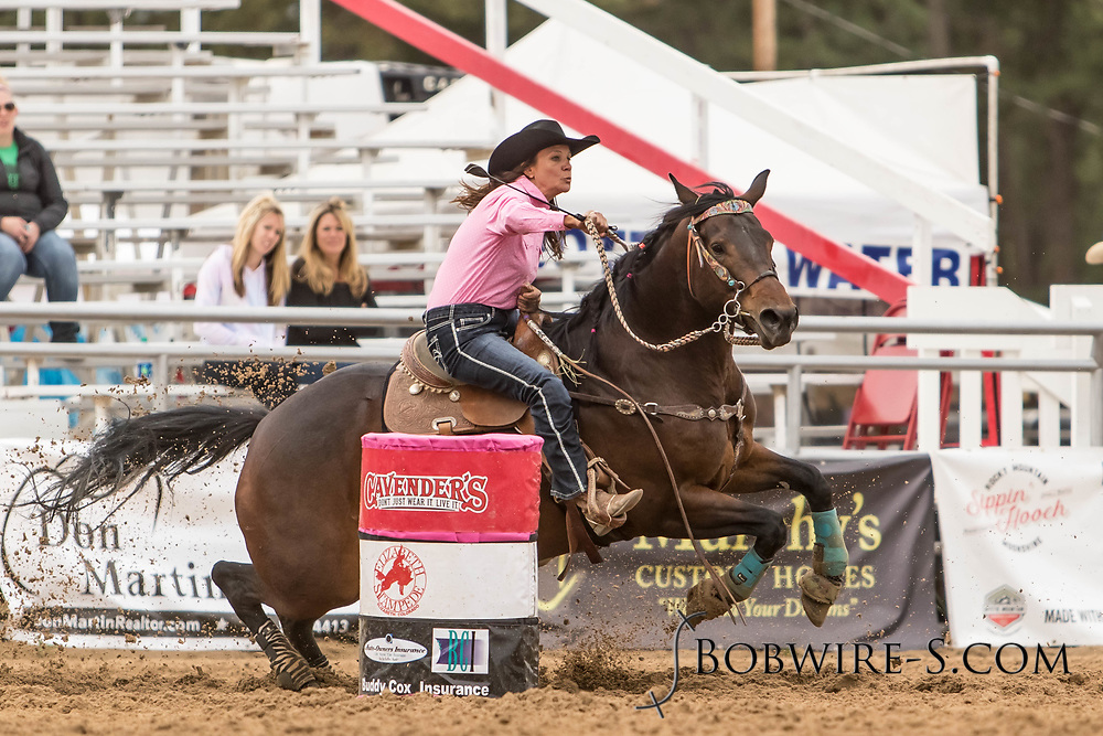 Mandy Tysdal makes her barrel racing run during slack at the Elizabeth Stampede on Sunday, June 3, 2018.