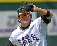 Kansas State left fielder Barrett Rice makes a running catch in the seventh inning against Baylor.  K-State defeated the Baylor Bears 3-1 at Tointon Stadium in Manhattan, Kansas, May 20, 2006.