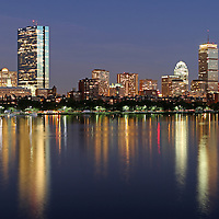 Scenic City of Boston skyline photography at twilight showing Boston Back Bay landmarks such as John Hancock building, Prudential Center and Mass Avenue bridge as seen from the Longfellow Bridge. <br />