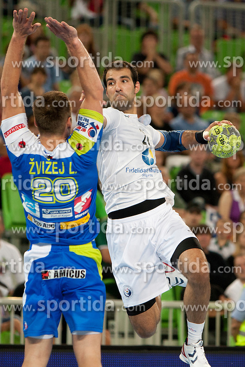 Luka Zvizej of Slovenia and Joao Ferazz of Portugal at handball match between National teams of Slovenia and Portugal of Qualifications for World Cup 2013, on June 9, 2012 in Arena Stozice, Ljubljana, Slovenia. (Photo By Urban Urbanc / Sportida.com)