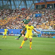 GRENOBLE, FRANCE June 18.  Sam Kerr #20 of Australia heads goal wars while defended by Allyson Swaby #17 of Jamaica during the Jamaica V Australia, Group C match at the FIFA Women's World Cup at Stade des Alpes on June 18th 2019 in Grenoble, France. (Photo by Tim Clayton/Corbis via Getty Images)