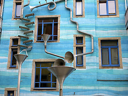 Funky drainage pipes on apartment building in the Kunsthofpassage courtyards in Dresden Germany  The series of courtyards have been specially designed by differnt architects on different themes
