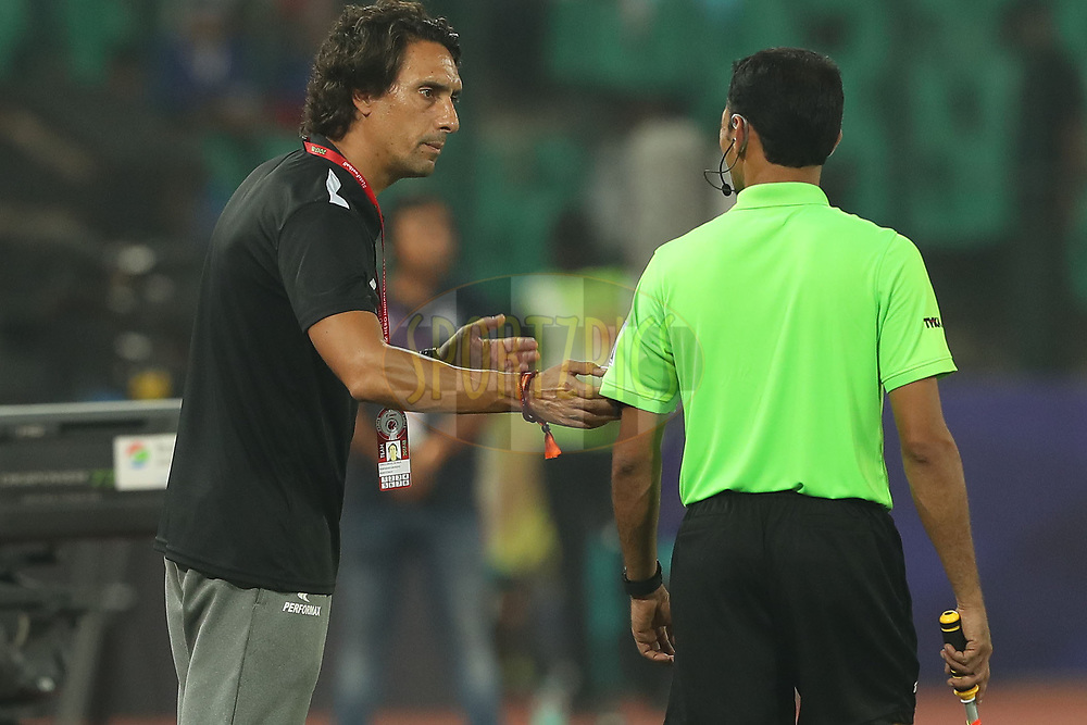 Joao Carlos Pires De Deus of Northeast United FC chats with the linesman during match 6 of the Hero Indian Super League between Chennaiyin FC and NorthEast United FC held at the Jawaharlal Nehru Stadium, Chennai, India on the 23rd November 2017<br /> <br /> Photo by: Ron Gaunt / ISL / SPORTZPICS