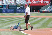 ANAHEIM, CA - MAY 06:  A groundskeeper lines the third base line before the Los Angeles Angels of Anaheim game against the Toronto Blue Jays on Sunday, May 6, 2012 at Angel Stadium in Anaheim, California. The Angels won the game 4-3. (Photo by Paul Spinelli/MLB Photos via Getty Images)