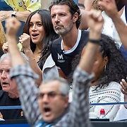 2019 US Open Tennis Tournament- Day Thirteen.    Meghan Markle, Duchess of Sussex reacts to a point while in the team box of Serena Williams of the United States, next to her coach Patrick Mouratoglou during the Women's Singles Final on Arthur Ashe Stadium during the 2019 US Open Tennis Tournament at the USTA Billie Jean King National Tennis Center on September 7th, 2019 in Flushing, Queens, New York City.  (Photo by Tim Clayton/Corbis via Getty Images)