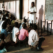 Kuito, Angola                             September, 2002<br /> <br /> Classes are held on the veranda of a primary school outside Kuito, Angola because the school is overcrowded. Photo by Lori Waselchuk/South Photographs