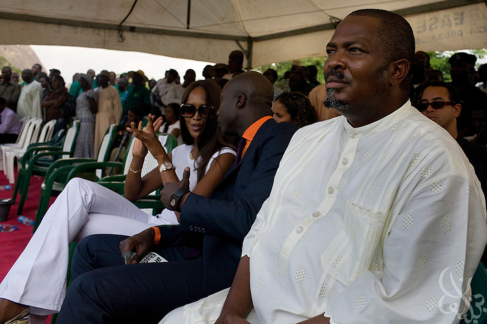 """ThisDay newspaper's Editor-in-chief Nduka Obaigbena (r), the organizer of the annual ThisDay Festival sits with celebrity guests super model Naomi Campbell and fashion designer Ozwald Boateng as they participate in a tree planting ceremony July 11, 2008 in Abuja, Nigeria. The 3rd Annual ThisDay Festival, themed """"Africa Rising"""", is an effort to promote positive images of Africa by celebrating its' music, fashion and culture.."""