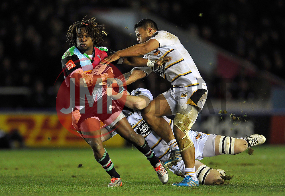Marland Yarde of Harlequins takes on the Wasps defence - Photo mandatory by-line: Patrick Khachfe/JMP - Mobile: 07966 386802 17/01/2015 - SPORT - RUGBY UNION - London - The Twickenham Stoop - Harlequins v Wasps - European Rugby Champions Cup