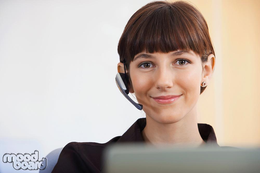 Businesswoman wearing telephone headset portrait
