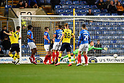 Goal - Rob Dickie (4) of Oxford United scores a goal to make the score 2-2 beating Alex Bass (35) of Portsmouth during the Leasing.com EFL Trophy match between Oxford United and Portsmouth at the Kassam Stadium, Oxford, England on 8 October 2019.